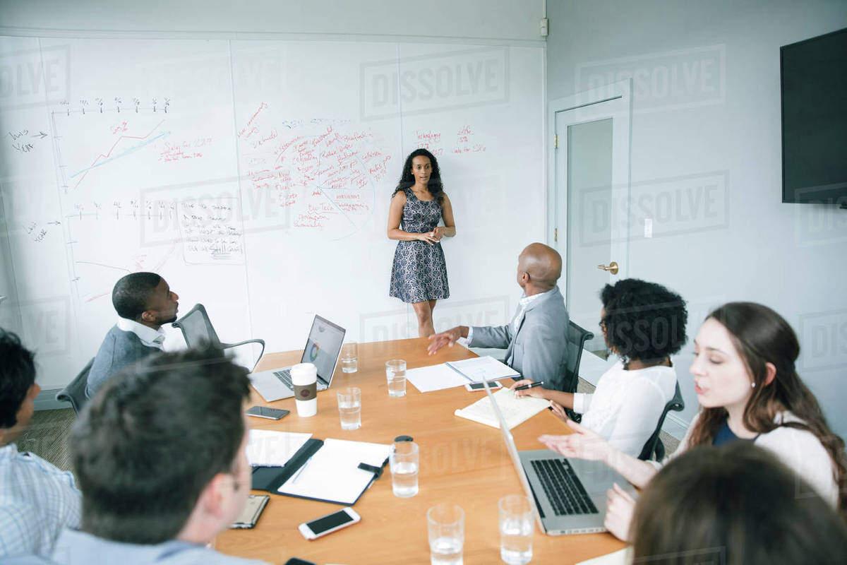 BUsiness woman whiteboard meeting