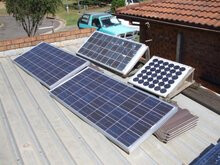 The Sweeneys' off-grid solar system, located on garage roof. The batteries and inverter are kept in the garage.