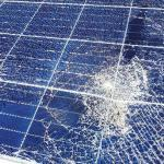 Solar panel with broken glass and damaged solar cells