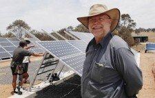 SUNNY FUTURE: Dr Larry Fingleton watches his new solar farm take shape. Photo: ZENIO LAPKA 122409zsolar1